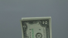 Placing a stack of two dollars bills Stock Footage