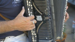 Man plays the accordion pushbutton cheerful music Stock Footage