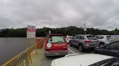 Driving on Daintree river vehicle ferry Stock Footage