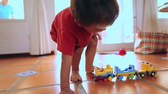 Child playing with toys  Boy playing with trucks and car toys Stock Footage