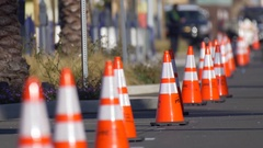 Orange traffic cones in the street at an event. Stock Footage