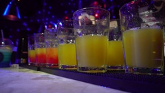 Alcohol Cocktail Drinks Poured in Nightclub Bar, Party, People at Night 4k Stock Footage