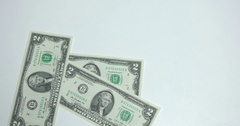 Throwing Money down table Stock Footage