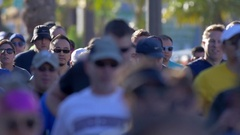 A crowd of people running in a 10K race, slow motion. Stock Footage