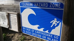 Tsunami Hazard Zone Warning Sign Tidal Wave Earthquake Danger Pan To Ocean 4k Stock Footage