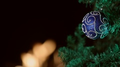 Blue Christmas ornament on tree with fire in background Stock Footage