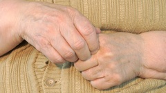 Elderly woman makes massages their of hands Stock Footage