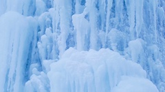 Ice surface. Icy waterfall. blue background Ice crystals. Stock Footage