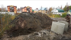 Excavator Digging Hole to Make a Pit Stock Footage