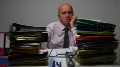 Archive Businessman Surrounded by Documents Looking Sad and Disappointed. Stock Footage