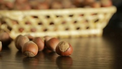 Filbert nuts. Placer in a wicker basket, close-up Stock Footage