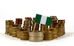 Nigeria flag waving with stack of money coins Kuvituskuvat
