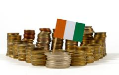 Ivory Coast flag waving with stack of money coins Stock Photos