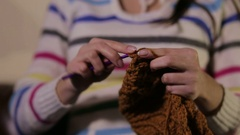 Woman knits a hat for a child. Stock Footage