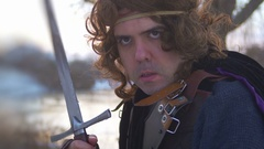 Man with sword medievel armored Stock Footage