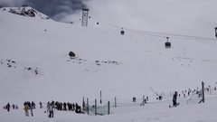 Timelapse panoramic ski slopes are snowed and means of transport that Stock Footage
