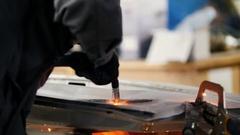 Welding industrial: worker repair detail in car service, close up Stock Footage
