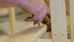 Guy building a chair in Kristiansand, Norway, hammer Stock Footage