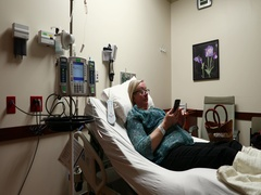 Cancer hospital woman receiving Chemo therapy while texting DCI 4K Stock Footage