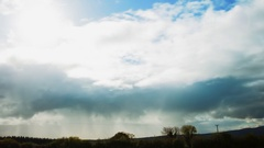 Idyllic Timelapse Of Clouds Rolling Over Landscape On Sunny Day Stock Footage