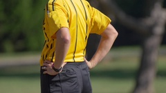 Details of a referee at a youth soccer football game. Stock Footage
