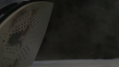 Steam billowing out of a hot iron in slow motion. Closeup shot Stock Footage