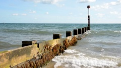 Bournemouth Wooden Sea Defence on Beach Stock Footage