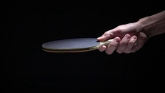 Hand holding table tennis racket and bouncing ping pong ball. Stock Footage