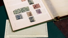 Old vintage stamp collection book and perforation gauge Stock Footage