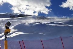 Off-piste slope during blizzard and sunlight blue sky with clouds Stock Photos