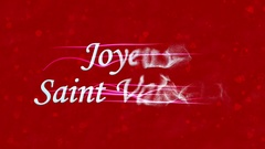 """Happy Valentine's Day text in French """"Joyeuse Saint Valentin"""" formed from dust Stock Footage"""
