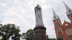 Virgin Mary statue in front of the Notre Dame Cathedral Stock Footage
