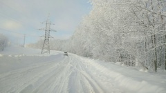 The vehicle rides on a snow-covered road impassable. Winter Mountain Road S.. Stock Footage
