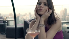Pensive, elegant woman sitting on terrace in bar, super slow motion 120fps Stock Footage