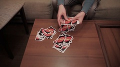 Girl deals cards on small table Stock Footage
