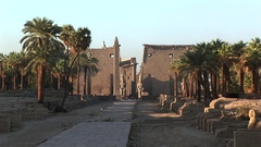 The Main Gate with obelisk in Sphinx Avenue in Luxor Temple medium shot Stock Footage