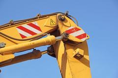 Detail of hydraulic bulldozer piston excavator arm Stock Photos