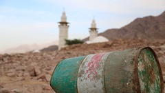 Iron barrel lies on the stony ground, mosque on the background in defocus Stock Footage