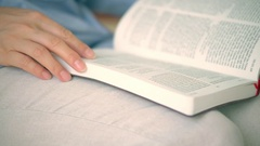 Woman is reading a Holy Bible Stock Footage