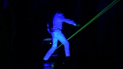 2 men dance and play electronic drums during the laser show Stock Footage