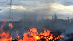 Fire and black smoke spread along the ground Stock Footage