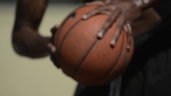 Extreme closeup details of basketball players passing the ball on a playground c Stock Footage