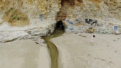 Panther Beach Cave Fly Away Stock Footage