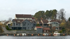 Houses and boats at Flekkerøya - Kristiansand - Norway Stock Footage