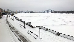 Frozen Dnipro river with Podil embankment Stock Footage