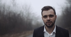 A young groom goes on the road with fog and good mood. 4k Stock Footage