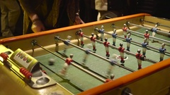 Table soccer game where players have fun in a club Stock Footage
