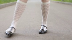 Dancer's legs. Girl dancing solo jazz swing dance on the city's square pavement Stock Footage