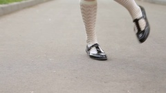 Dancer's legs close-up loop. Girl dancing solo jazz swing dance on the city's Stock Footage