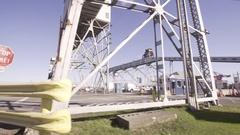 Driving Under Grain Conveyors Stock Footage